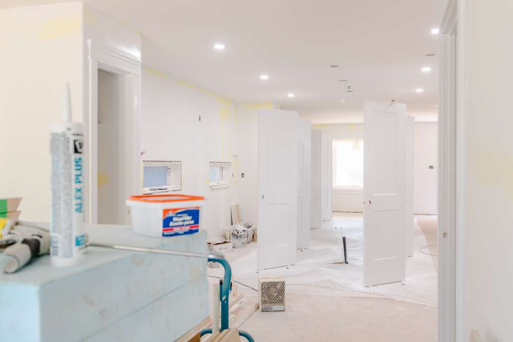 Indoor renovation with paint buckets and primer paint
